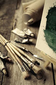 Artistic paintbrushes, tubes of oil paint, palette knife and eas — Stock Photo