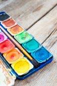 Set of watercolor paints on wooden background. — Fotografia Stock