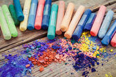 Collection of rainbow colored pastel crayons with pigment dust. — Stock Photo