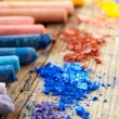 Collection of rainbow colored pastel crayons with crushed chalk. — Stock Photo #59723107
