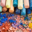 Collection of rainbow colored pastel crayons with crushed chalk — Stock Photo #59723145