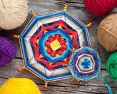 Two knitted tibetan mandala from threads and yarn on wooden rust — Foto Stock