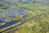 Aerial view of bog landscape and train with turf — Stock Photo