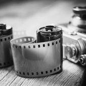 Old photo film cassette and retro camera on background. Vintage  — Stock Photo