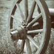 Vintage stylized photo of wooden cart wheel — Stockfoto #71961481