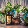 Still life with three wedding bouquets and candles, vintage styl — Stock Photo #73136523