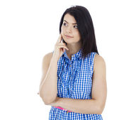 Beautiful girl in a blue blouse thoughtful — Stock Photo