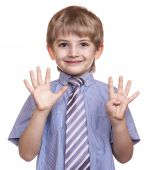 Smiling boy shows nine fingers on a white background — Stock Photo