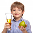 Cute caucasian boy holding a glass of pear juice and pear. — Stock Photo #57512137