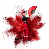 Young woman dancing flamenco against explosion — ストック写真