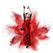 Young woman dancing flamenco against explosion — Stock Photo