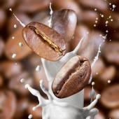 Falling roasted coffee beans with steam and milk — Foto Stock