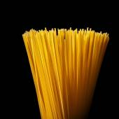 Italian spaghetti isolated on black — Stock Photo