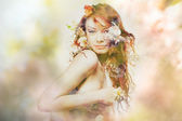 Double exposure portrait of young woman in flowers — Stock Photo