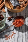Saffron with various spices on wooden background — Stock Photo