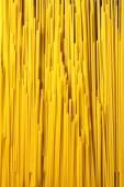 Italian spaghetti on wooden background — Stock Photo
