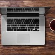 Open laptop and cup of tea — Stock Photo #74469027