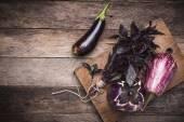 Aubergines and basil — Stock Photo