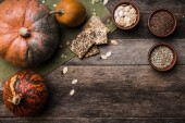 Pumpkins with seeds and cookies — Photo