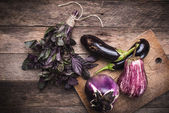 Rustic style Aubergines and basil — Stock Photo