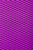 Synthetic magenta cloth. grid closeup. macro — Stock Photo