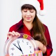 Blue-eyed beautiful girl in santa hat with clock — Stock Photo #59468915