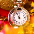 Christmas card. Silver vintage watch on a red background with go — Stock Photo #59888237