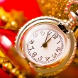 Christmas card. Silver vintage watch on a red background with go — Stock Photo #59888577
