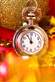 Christmas card. Silver vintage watch on a red background with go — Stock fotografie