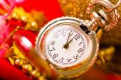 Christmas card. Silver vintage watch on a red background with go — Foto de Stock