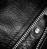 Black leather clothing with a zipper. macro photo — Stock Photo