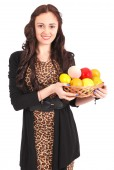 Young girl with a fruit basket — Stock Photo