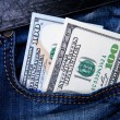 Money in the pocket of jeans — Stock Photo #66830265