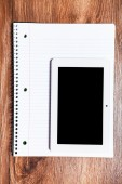 Notebook isolated on a wooden background — Stock Photo
