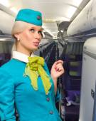 NOVOSIBIRSK, RUSSIA - JUNE 26, 2014: S7 Crew member (flight attendant) Dressed In Blue Uniform. S7 is the founding airline of world's 3nd largest airline alliance - Oneworld. — Stock Photo