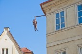 Hanging out sculpture — Stock Photo
