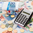 Calculator with Euro notes and coins — Stock Photo #61786055