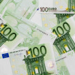 Many of one hundred euro banknotes lie side by side — Stock Photo #61957165