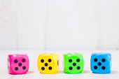 Four  dice on the wooden background — Stock Photo