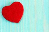 Heart on blue wooden background — Stock Photo