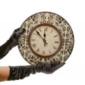 Hands in black gloves hold retro clock. isolated on white backgr — Stock Photo