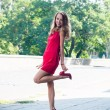 Lady in red dress dancing — Stock Photo #53487633