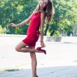 Lady in red dress dancing — Stock Photo #53487667