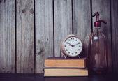Siphon, alarm clock and vintage books  — Stok fotoğraf