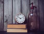 Siphon, alarm clock and vintage books  — Fotografia Stock