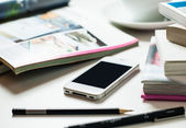 Smartphone on office table — Stock Photo
