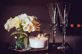 Candles and champagne glasses — Stock Photo