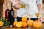 Man pours white wine — Stock Photo