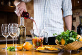 Pouring red wine into a carafe — Stock Photo