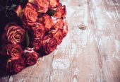 Roses on an old wooden board — Stock Photo